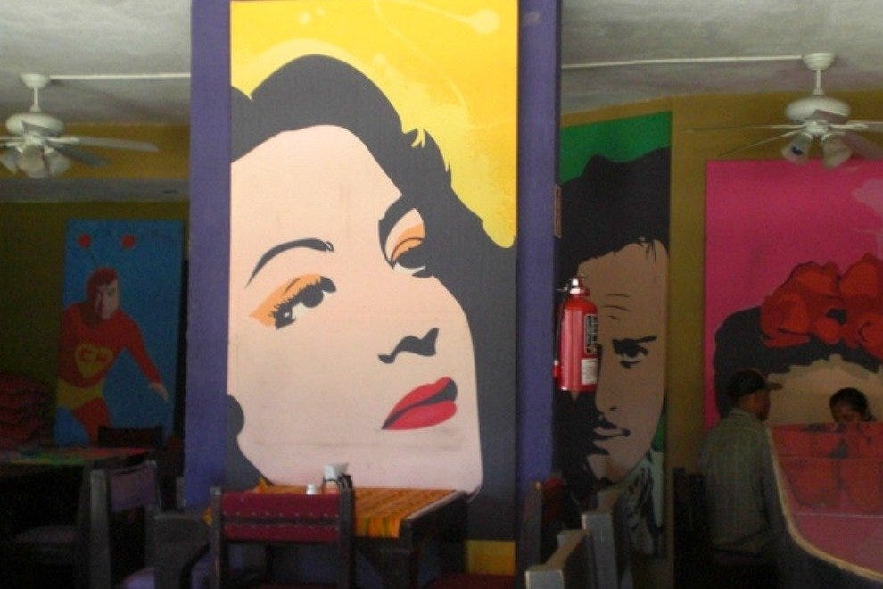 Baja Maria's walls are lined with vivid paintings of golden age Mexican movie stars like María Félix and Pedro Infante
