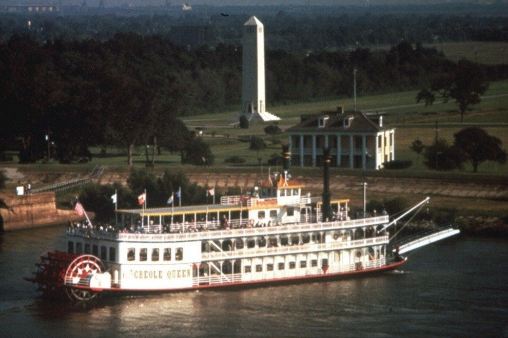 "The ""Creole Queen"" steamboat glides by the Chalmette Battlefield at night"