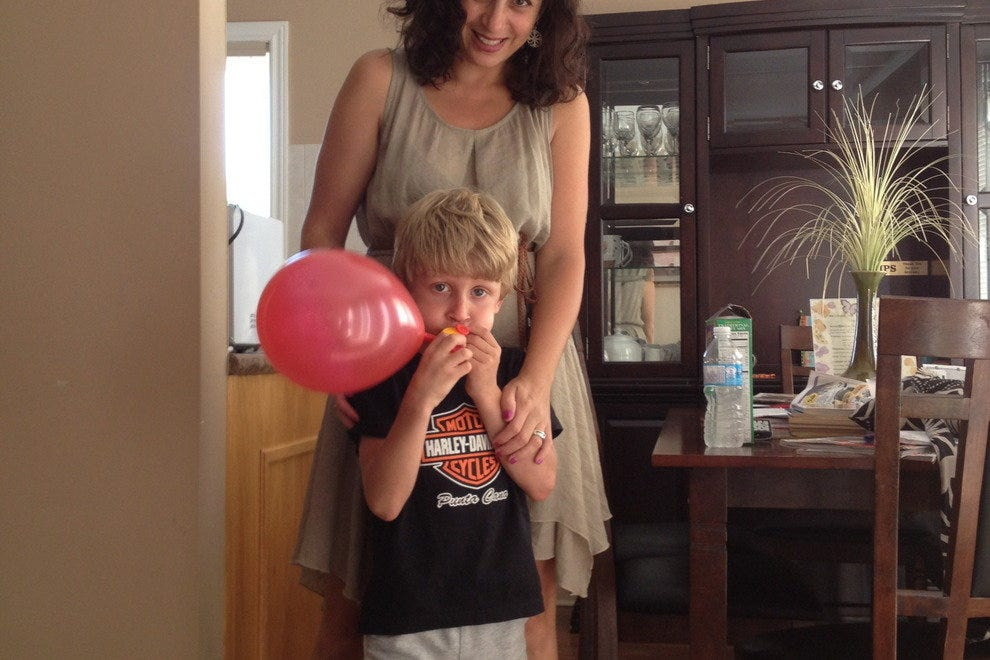 The author playing with her son in their apartment rental in Toronto. Open living spaces are what appeals to her family when it comes to vacation rentals.
