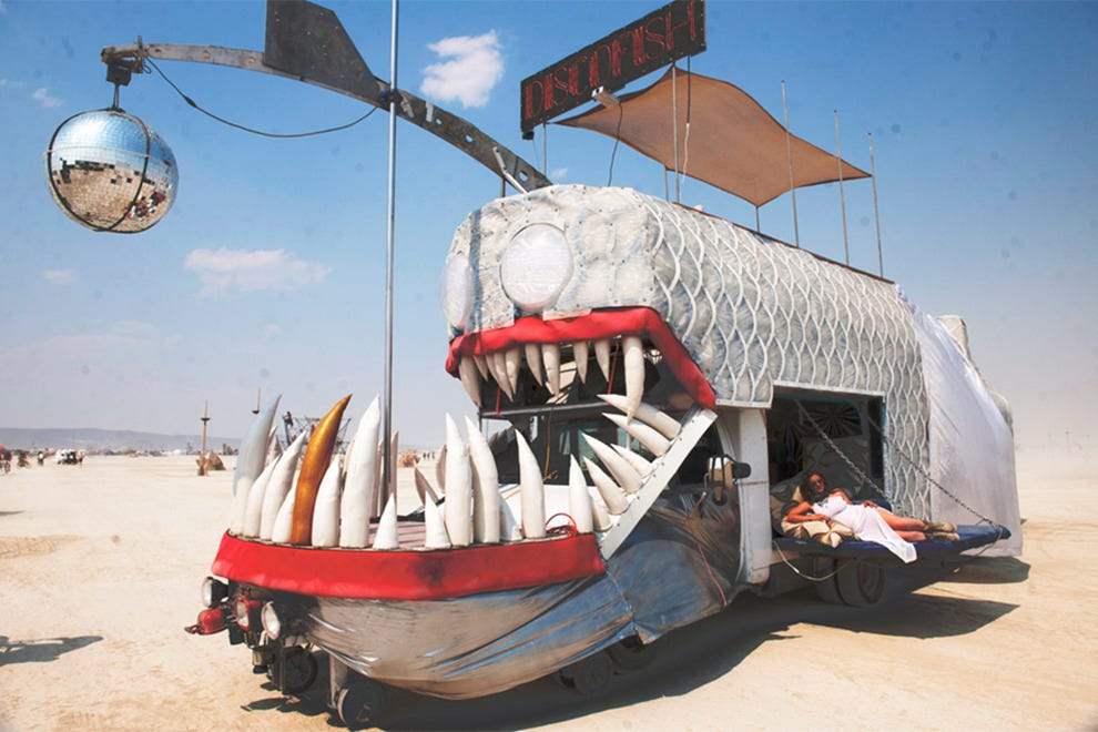 The Discofish Camp's Art Car complete with shade and a disco ball