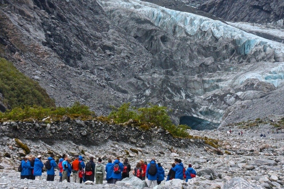 A group prepares to explore Abel Tasman Glacier with a guide.