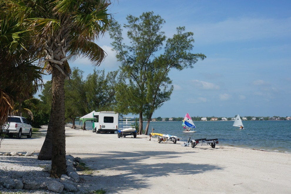 Pull your car right up to the water on the Sanibel Causeway Beach