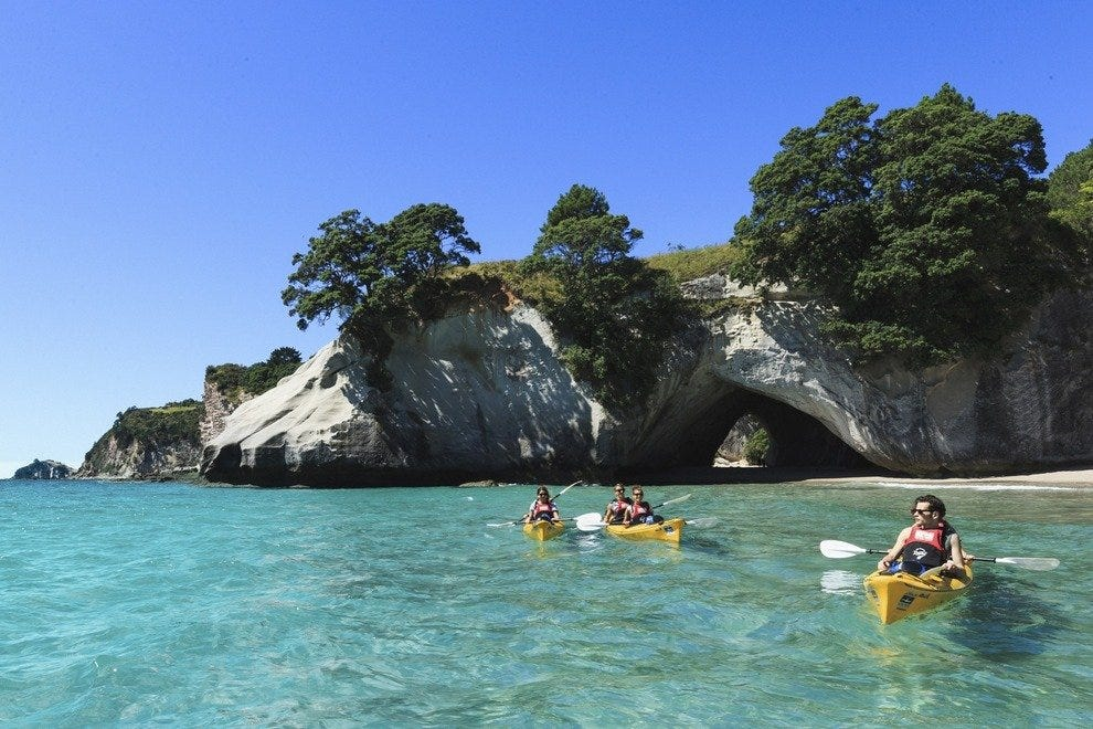 Paddling a kayak in Cathedral Cove is a popular North Island outing.
