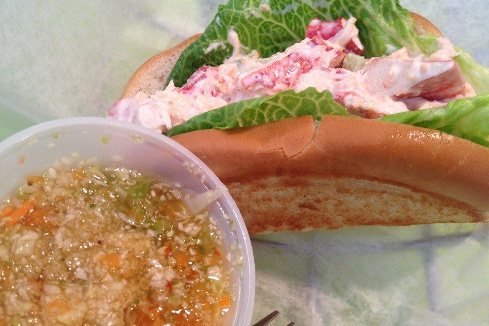 Bennett's popular lobster roll, served with a side of pepper slaw
