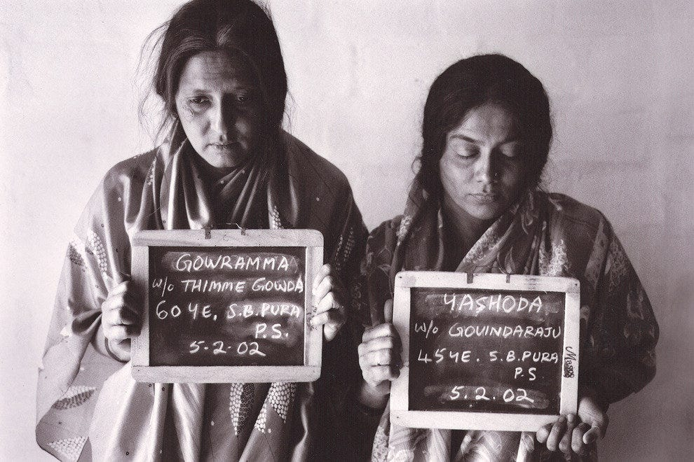 "Gallery-goers find works like ""Criminals"" (after 2001 newspaper photograph) from the project ""Native Women of South India: Manners and Customs"""