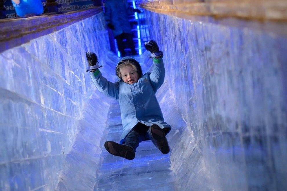 At Gaylord National Resort, a child careens down a slide made entirely of ice