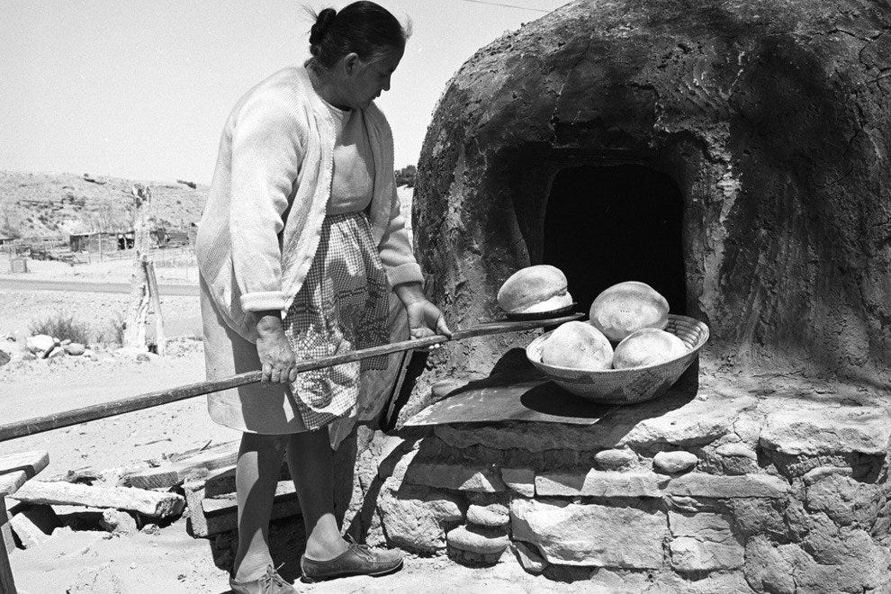Native bread baking in an horno.
