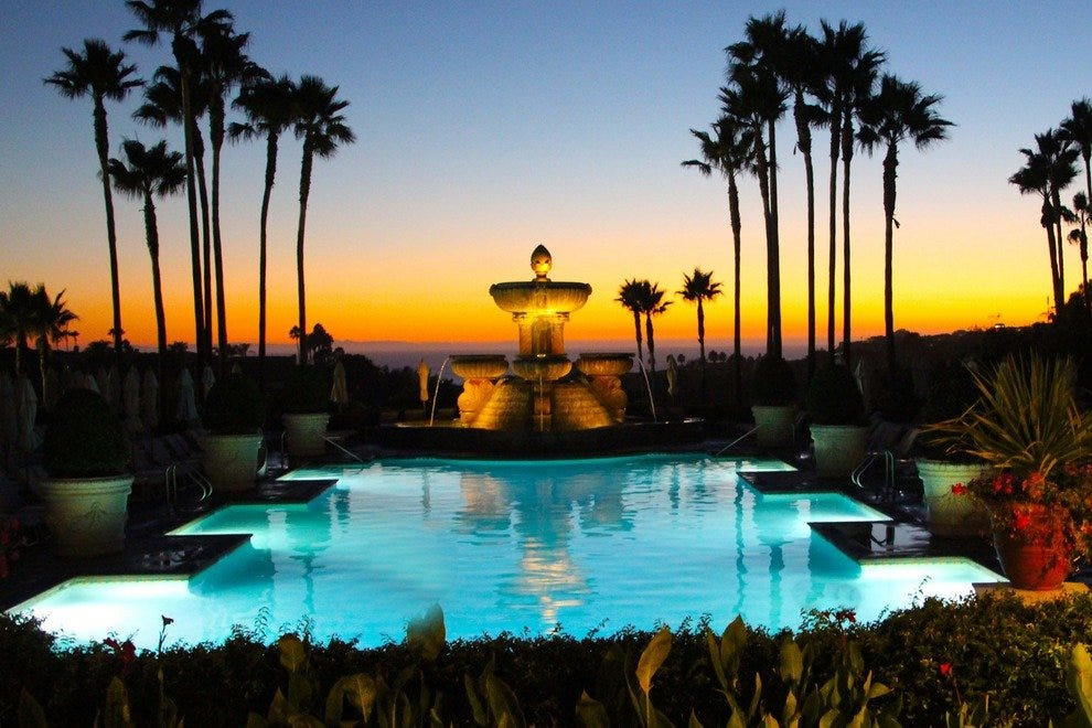 Savor the sunset over the St. Regis Monarch Beach pool.