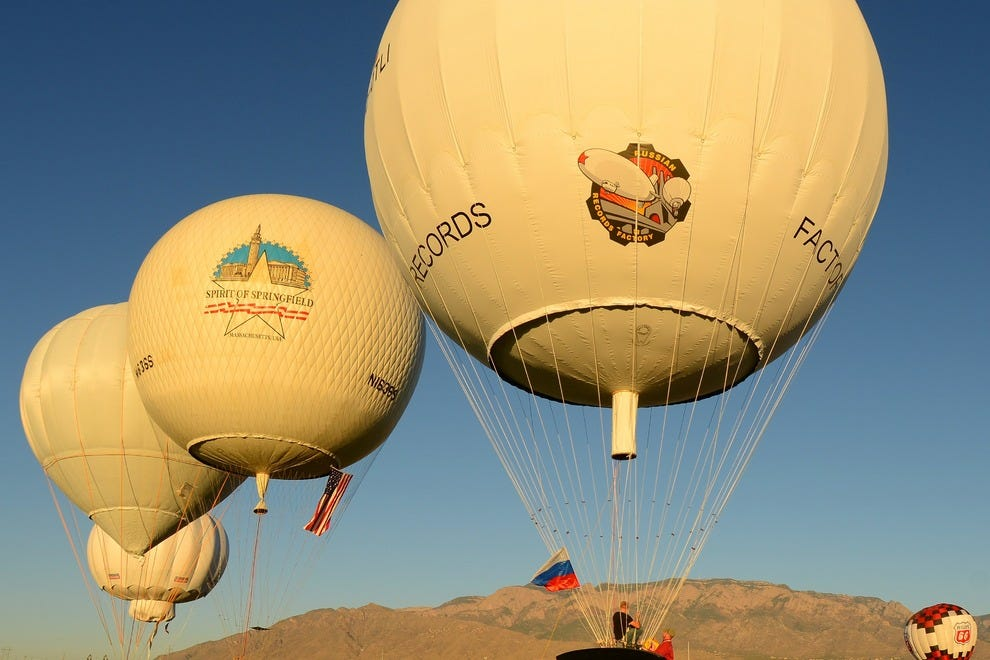 The Albuquerque International Balloon Fiesta sees two gas balloon races launch from its field this year, the Gordon Bennett and the America's Challenge. These races are unique in that helium-filled balloons (as opposed to hot-air balloons) are used. The t
