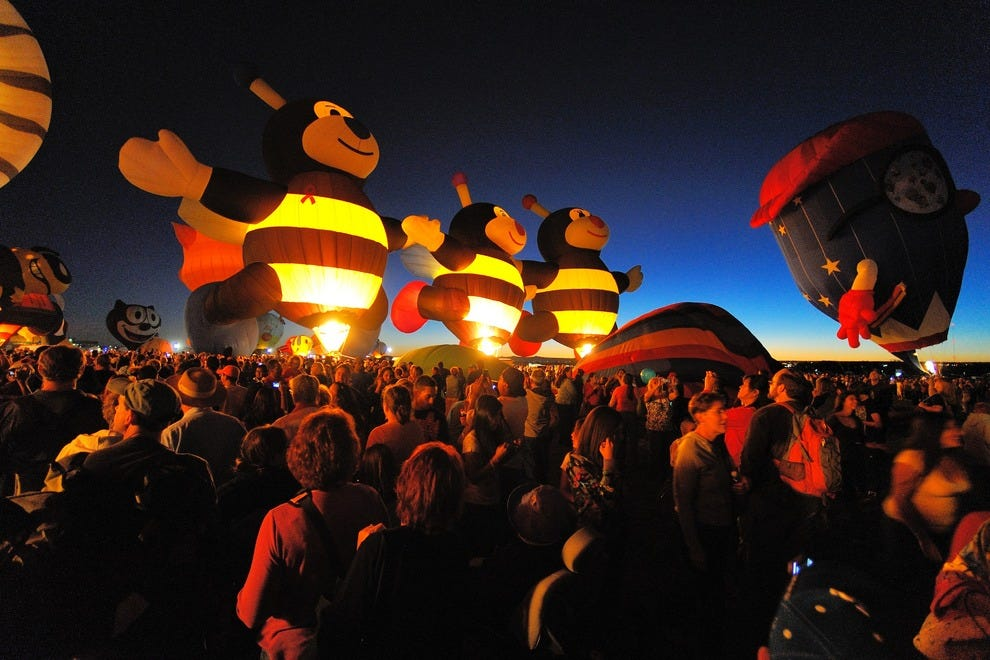 "The ""Little Bees"" special shape balloons from Arizona are a crowd favorite, seen here glowing during a Special Shape Glowdeo (in which only special shape balloons participate in a balloon glow). This year's Glowdeo takes place Oct. 9 and 10 beginning at 5"