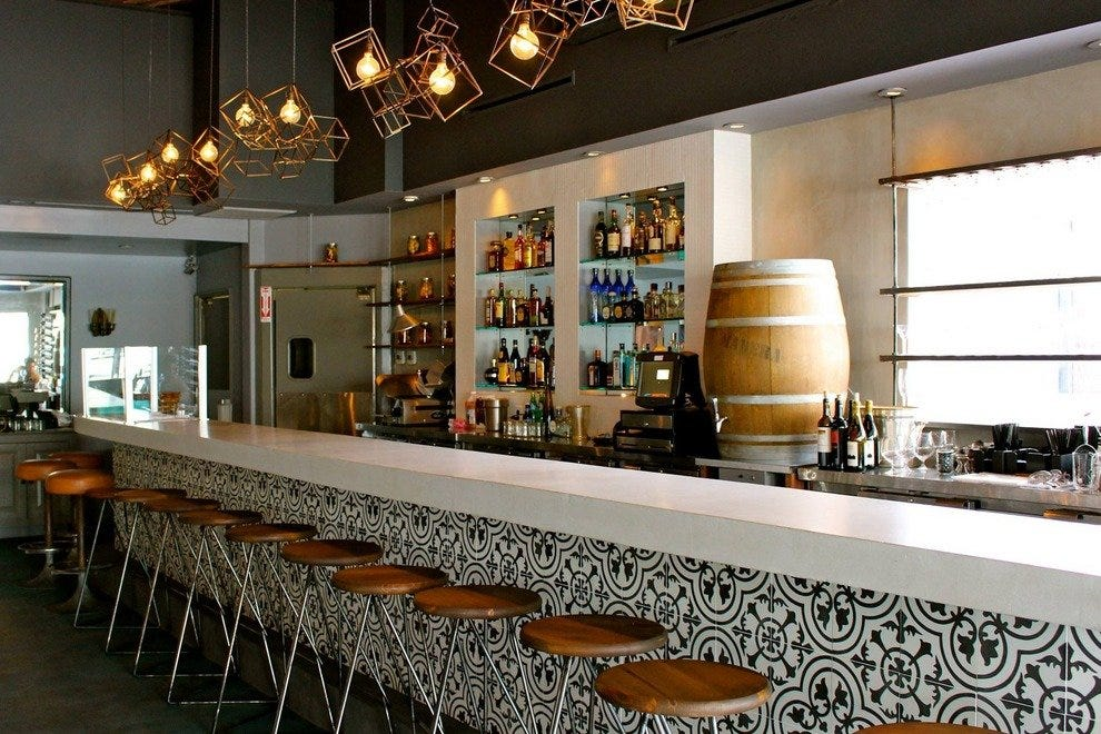 There are plenty of seats at Madera Kitchen's tiled bar