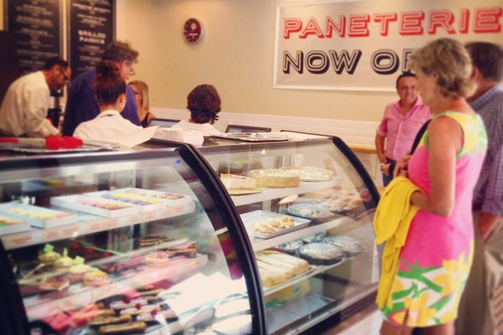 Paneterie patrons, in awe over the pastry display case