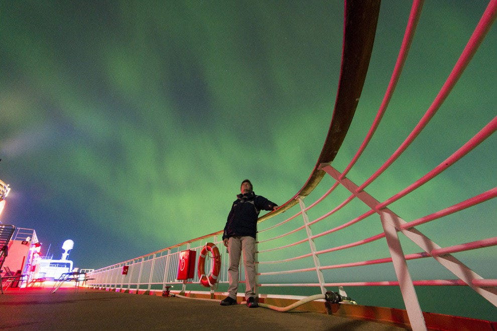 Northern Lights dance above the sun deck of the MS Trollfjord.