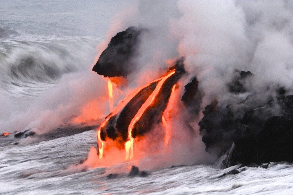 Lava flows into the sea from active volcano Kilauea on the island of Hawaii.