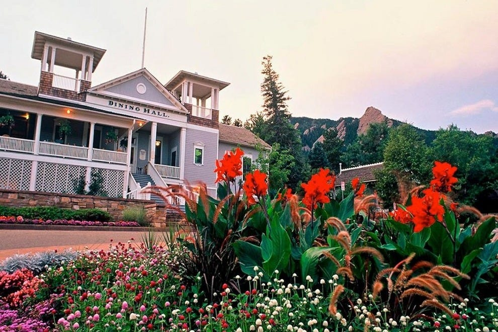 Flowers bloom,as the Flatirons tower above Chautauqua Dining Hall