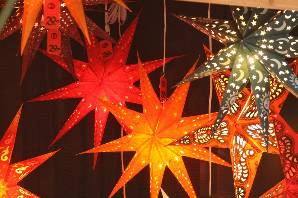 Among the items sold in booths at Denver Christkindl Market are handcrafted goods such as these bright paper lanterns from Paper Star