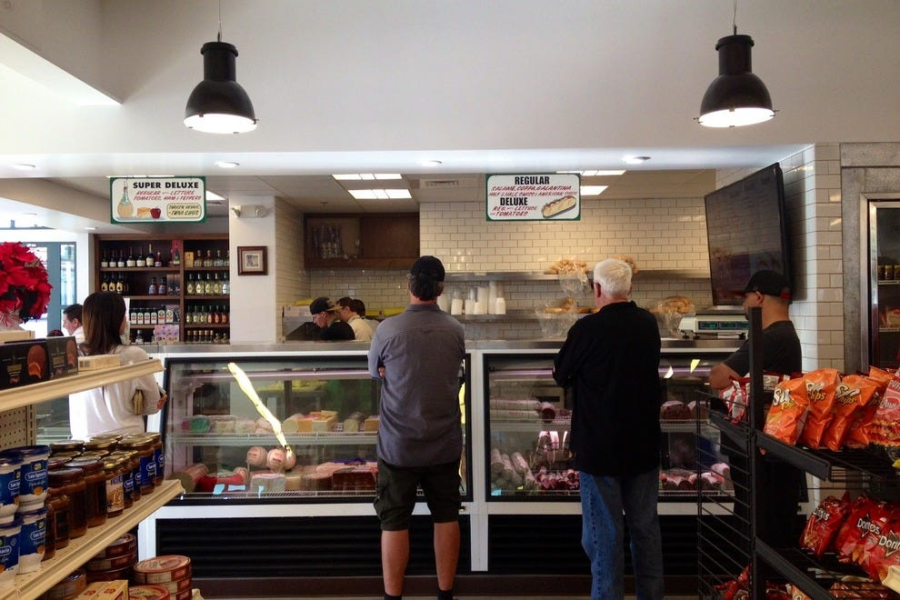Shop for gourmet groceries, and then step up to the deli counter at Tino's