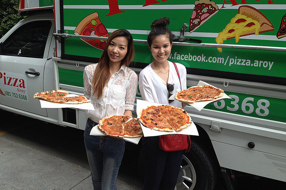 Find pizza pies by the truckload at Pizza Aroy