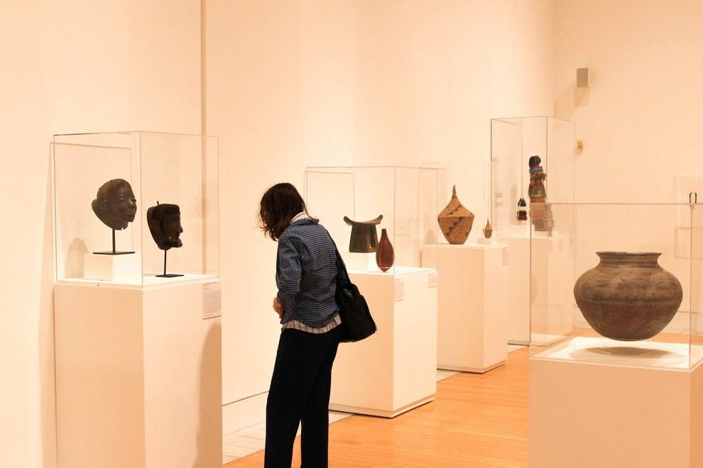 Guest gazes at works in the Lowe Art Museum's new African art exhibition