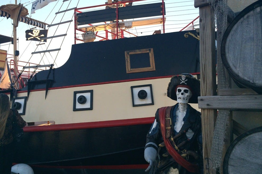 Passengers love to pose with this pirate before boarding his ship in Estero Bay