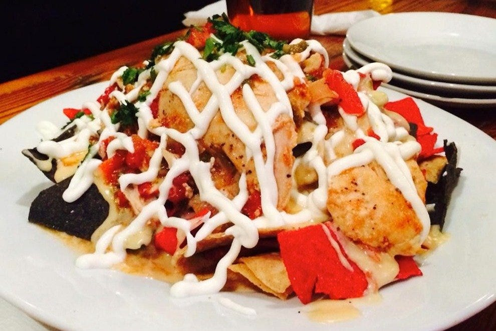 Loaded Nachos on the outdoor patio are the perfect fuel for an impending big night out
