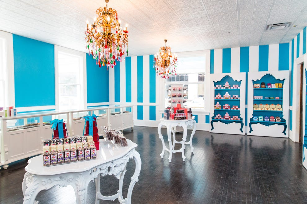 Bold colors and sparkling chandeliers transport you to a real-life candy land