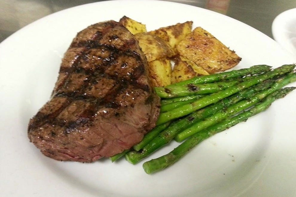 This isn't your ordinary pub fare: filet mignon with duck fat, rosemary roasted potatoes and grilled asparagus