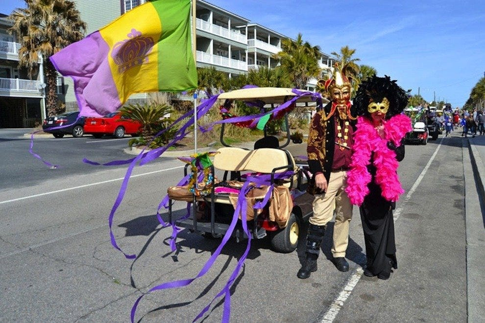 Colorful costumes, masks and beads are displayed at FollyGras