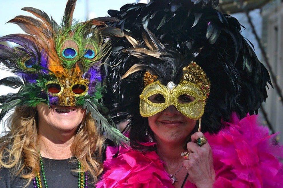 Festival-goers show off their costumes and masks at FollyGras 2014
