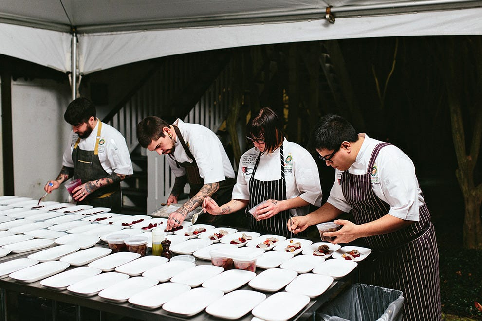 Chefs put the finishing touches on tasty plates at the Charleston Wine + Food Festival
