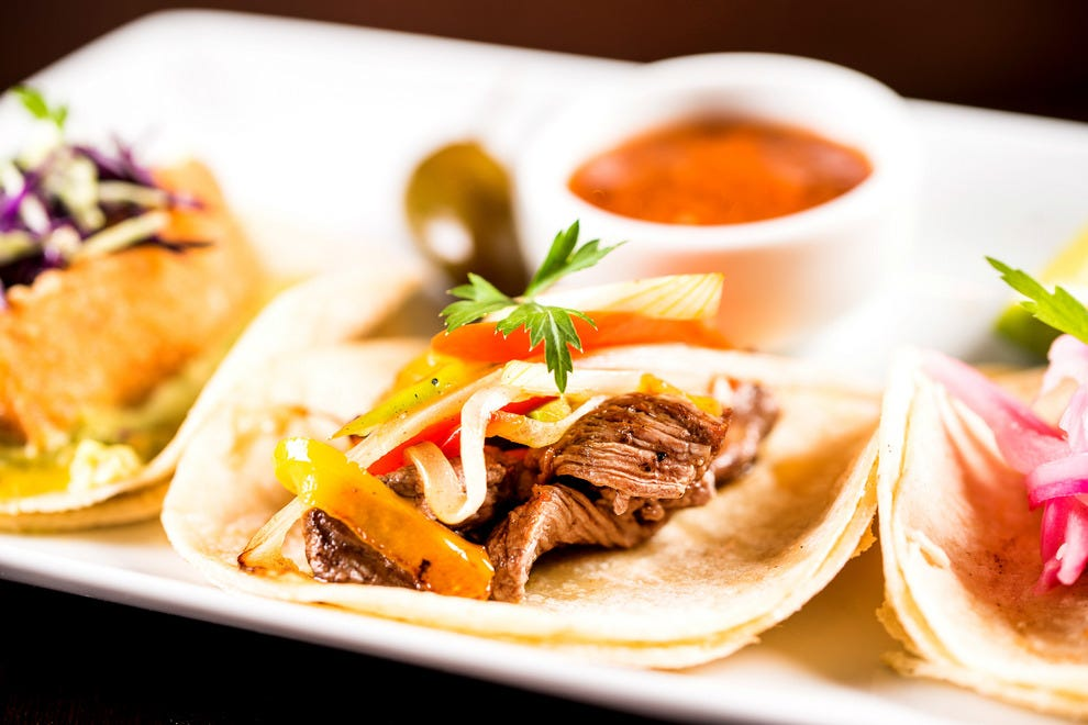 The trio of tacos at La Calaca is a highlight of the menu
