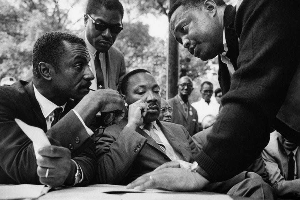 On-the-spot meetings were common. In this photo, (left to right) Rev. Fred Shuttlesworth; Bernard Lee; Rev. Martin Luther King, Jr.; and Hosea Williams confer during a rally in Kelly Ingram Park