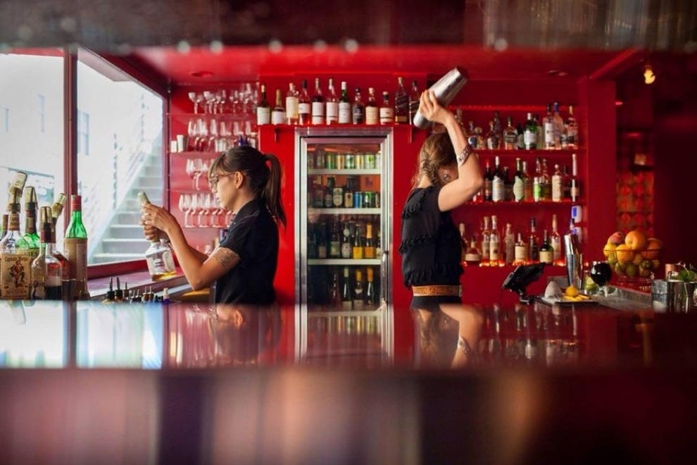 Bartenders prepare drinks at R Bar in Tucson