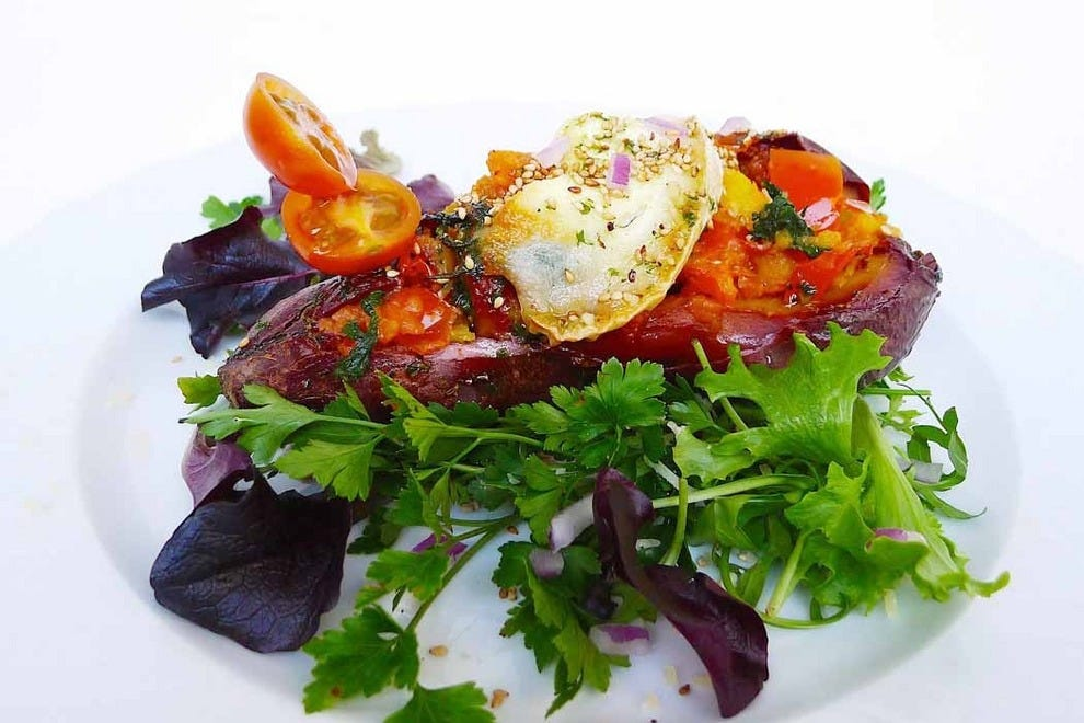 Main dishes include tasty purple salad with stuffed and garnished sweet potato