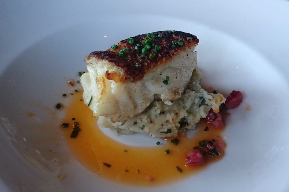 The Cod Cornucopia is a pan-roasted filet served atop warm potato salad, with a spicy chorizo viniagrette