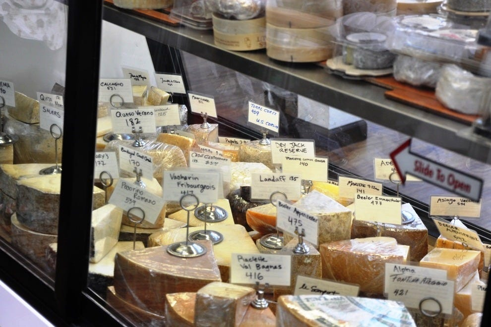 A case of cheese at Cheesemongers, waiting to be cut to order