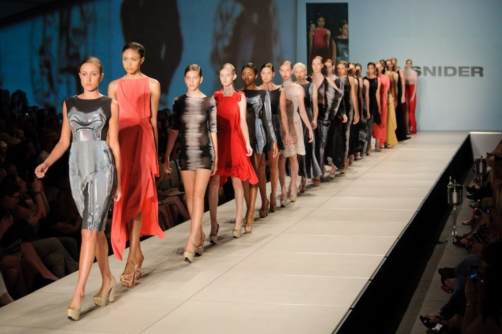 Models showcase a featured designer's collection on the Charleston Fashion Week runway