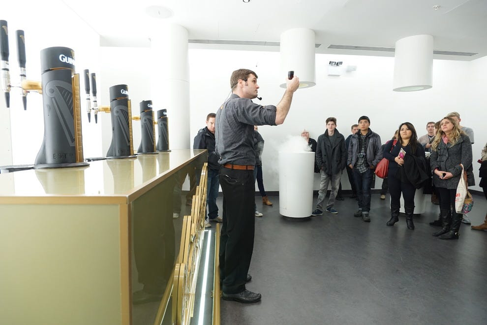 Visitors smell the ingredients used to make Guinness, while tasting the final product
