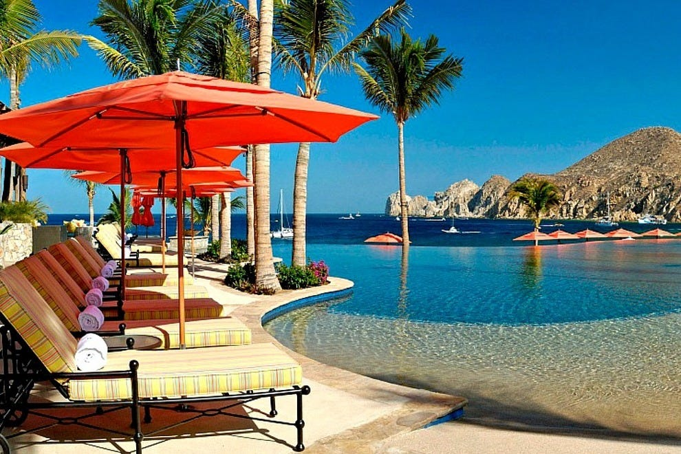 Set at the foot of Médano Beach, Hacienda Beach Club & Residences commands spectacular views of Cabo San Lucas Bay and the evocatively shaped granitic rock formations at Land's End