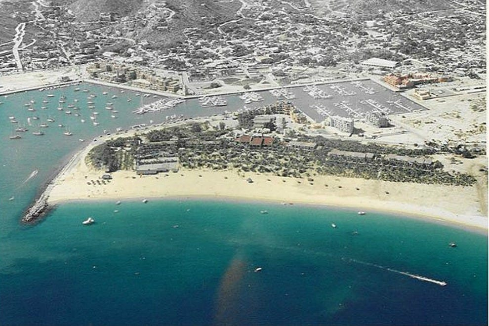 The property dates back to the early days of tourism in Cabo San Lucas, when it was a favorite of movie stars like John Wayne. This aerial view shows the Hotel Hacienda (at the far left of the beach) and the Marina, as they looked during the mid-1980s.