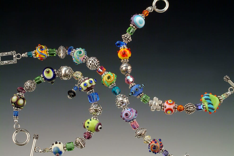 Artist Rick Sadler's signature lamp glass jewelry is found in collections worldwide