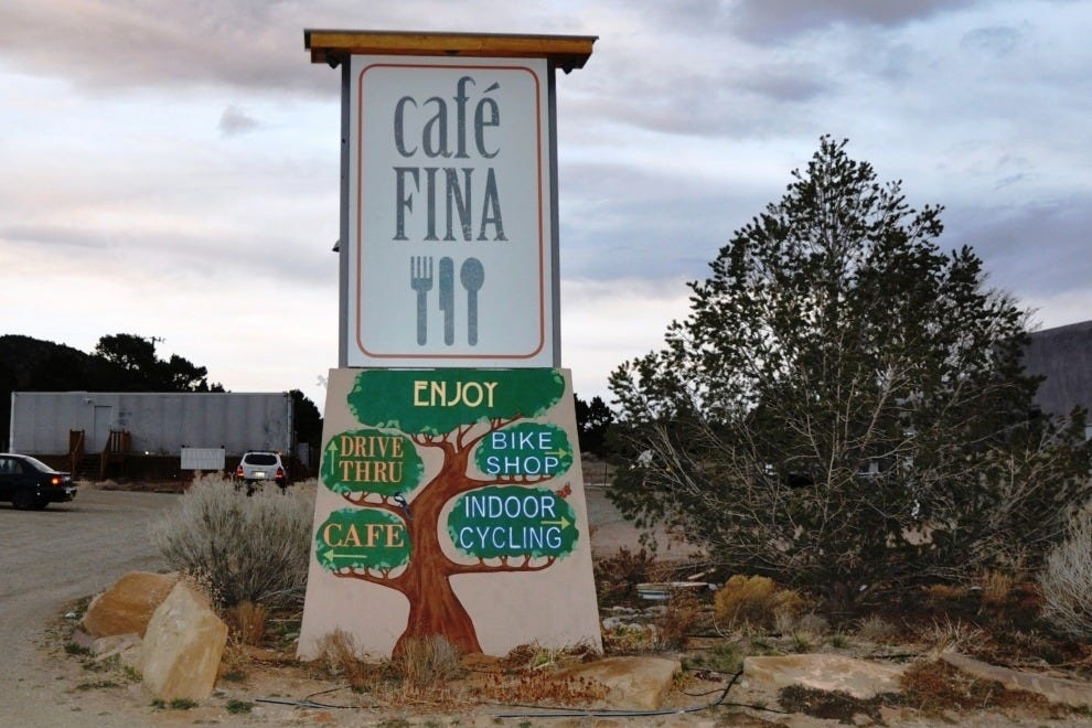 The colorful Cafe Fina sign greets you from the highway