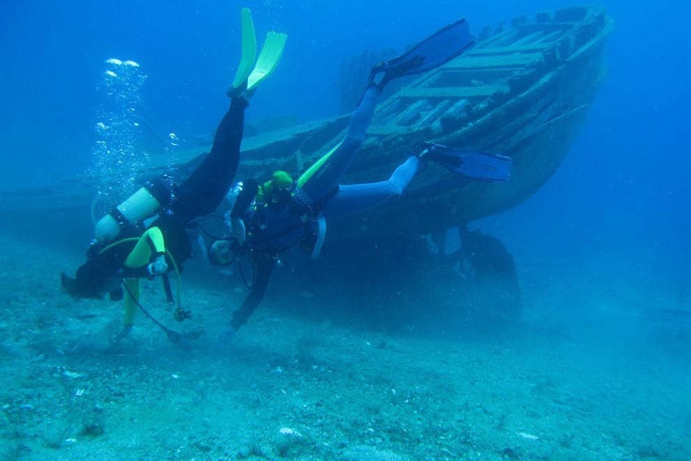 Get PADI-certified and take a diving trip somewhere exotic like Greece