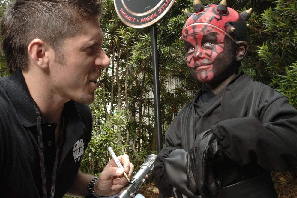 Actor Ray Park (Darth Maul) signs this little Sith's lightsaber