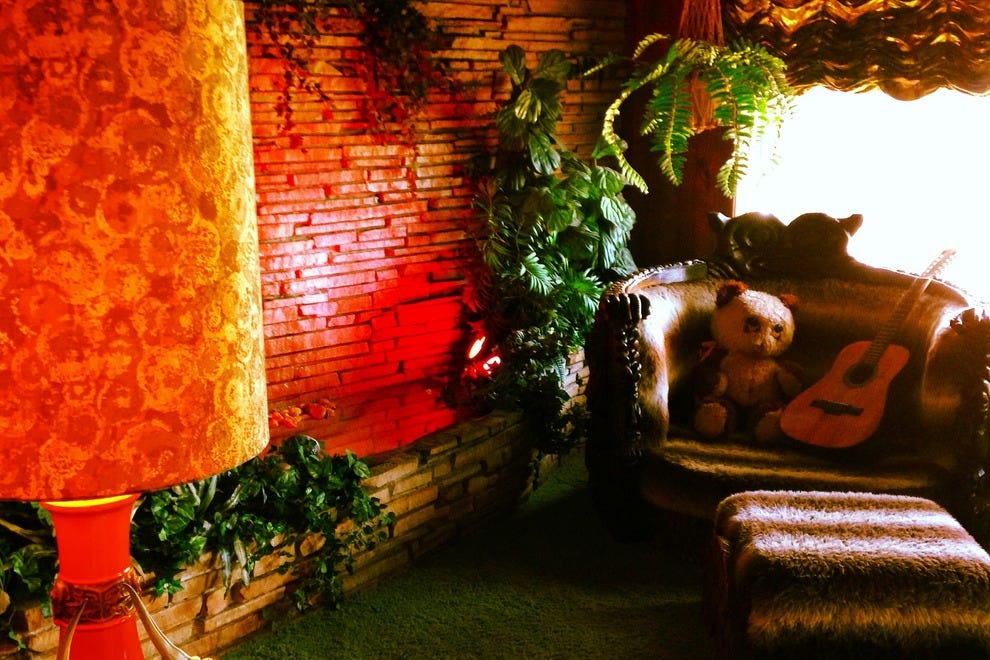 Visitors to Graceland enjoy gems like the sunken living room with vibrant green shag carpet.
