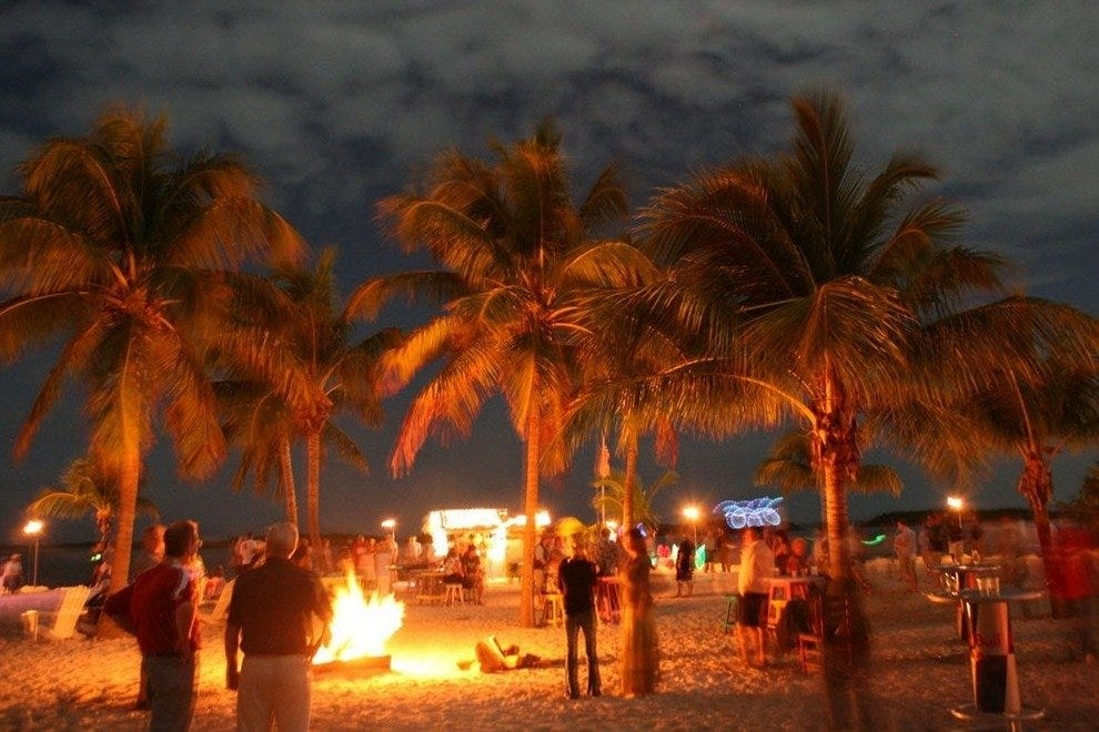 Bonfires, tiki torches and fire dancers set the beach ablaze at dusk