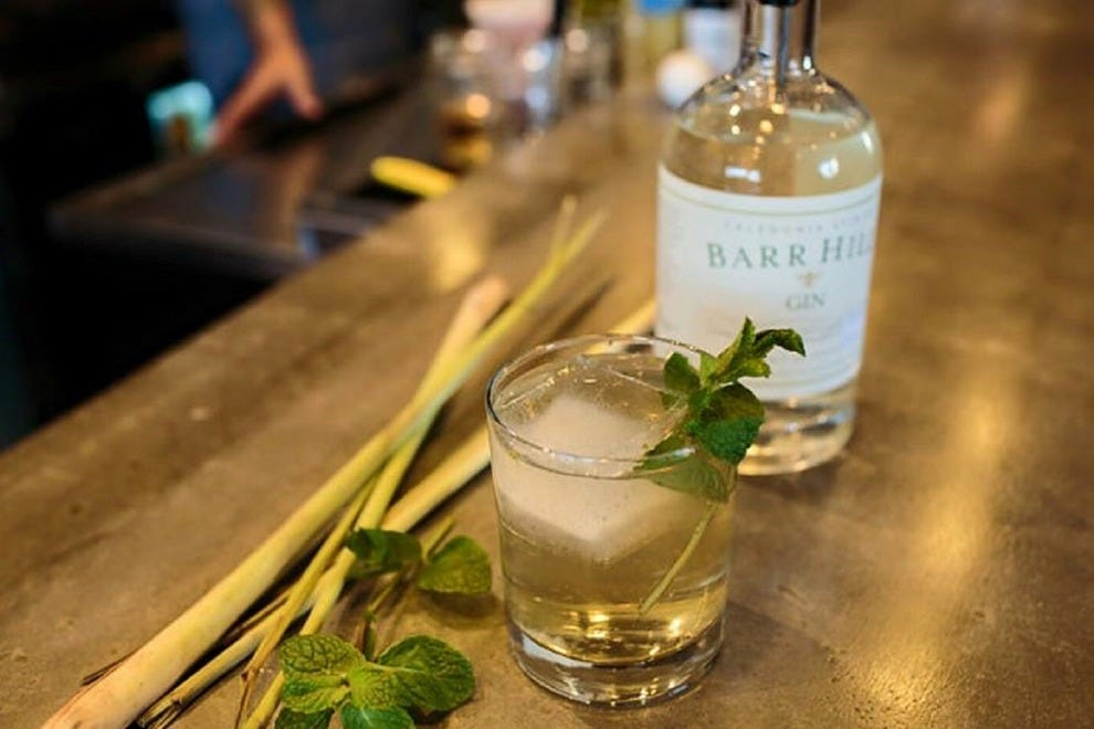 Need a cool drink on a hot day? Try the refreshing Social Gathering, which features Barr Hill gin, mint and lemongrass syrup