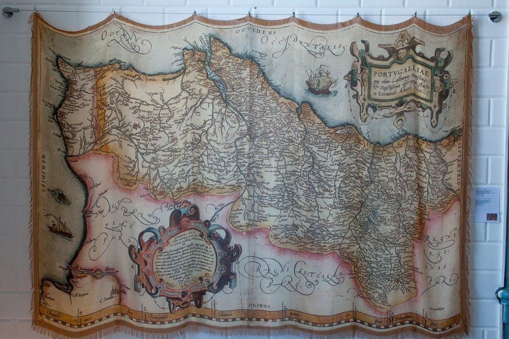 Scarves on sale at Antiflop include this example, featuring a 1561 map of Portugal that was created by the 16th-century cartographer Fernando Álvaro Seco