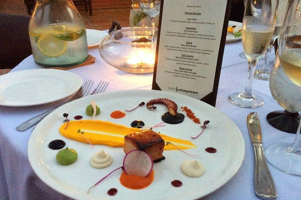 "Tadd Chapman's artistry is evident in every dish, such as this colorful combination featuring pork belly and ""pulpo"" (grilled octopus)"
