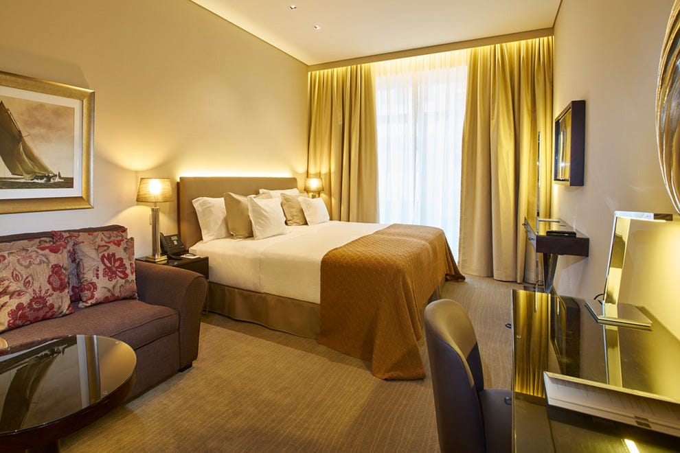 A spacious and stylish Deluxe Room at Hotel Porto Bay Liberdade